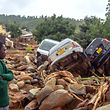 A man stands next to the wreckage a vehicles washed away f March 18, 2019 in Chimanimani, eastern Zimbabwe, after the area was hit by the cyclone Idai. - A cyclone that ripped across Mozambique and Zimbabwe has killed at least 162 people with scores more missing. Cyclone Idai tore into the centre of Mozambique on the night of March 14 before barreling on to neighbouring Zimbabwe, bringing flash floods and ferocious winds, and washing away roads and houses. (Photo by Zinyange AUNTONY / AFP)