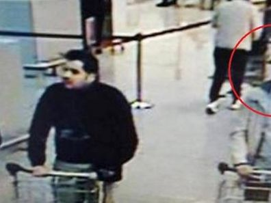 The man in the hat,believed to be the fugitive third Brussels airport bomber, Faycal Cheffou, has been charged