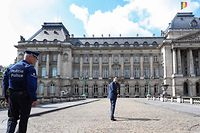 Belgium's Flemish right-wing Vlaams Belang party chairman Tom Van Grieken (C) looks back as he arrives for a meeting with the King at the Royal Palace in Brussels, on May 29, 2019, three days after regional, federal and European elections. (Photo by BENOIT DOPPAGNE / Belga / AFP) / Belgium OUT