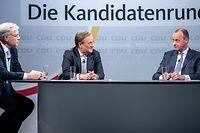 """ARCHIV - 08.01.2021, Berlin: Die drei Kandidaten für den CDU-Parteivorsitz Friedrich Merz (r-l) , Armin Laschet und Norbert Röttgen sitzen nach einer Diskussionsrunde im Konrad-Adenauer-Haus. Vor der Wahl des CDU-Bundesvorsitzenden stellen sich die Kandidaten in der per Livestream übertragenen Diskussion erneut den Mitgliedern.  (zu """"Laschet, Merz, Röttgen - die Kandidaten für den CDU-Vorsitz"""") Foto: Michael Kappeler/dpa +++ dpa-Bildfunk +++"""