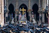 This general view shows debris inside the Notre-Dame-de Paris Cathedral in Paris on April 16, 2019, a day after a fire that devastated the building in the centre of the French capital. - Pledges from French billionaires, businesses and the public sector to help rebuild Notre-Dame cathedral have reached nearly 700 million euros (790 million dollars) amid an outpouring of public support for one of Europe's most iconic monuments. (Photo by Christophe PETIT TESSON / POOL / AFP)