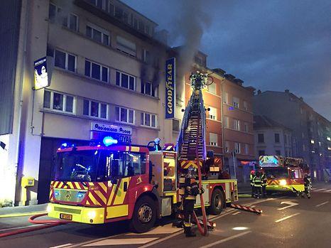 Fire in an apartment building opposite Den Atelier