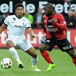 Guingamp's French forward Yannis Salibur (R) vies with Metz' French defender Matthieu Udol during the French L1 football match Olympique de Marseille (OM) vs SC Bastia on May 20, 2017 at the Velodrome stadium in Marseille, southern France.  / AFP PHOTO / FRED TANNEAU