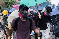 TOPSHOT - Tear gas is fired by police as protesters attempt to escape the campus of the Hong Kong Polytechnic University in the Hung Hom district of Hong Kong on November 18, 2019. - Hong Kong riot police swooped on pro-democracy protesters trying to flee a university they had set ablaze, in one of the most violent confrontations seen in nearly six months of unrest. Hundreds of demonstrators clashed throughout the day with police who had threatened to use deadly force, as protests also flared in other parts of the city. (Photo by ANTHONY WALLACE / AFP)
