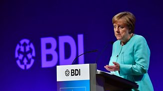 German Chancellor Angela Merkel delivers her speech at a two-day meeting of the Federation of German Industry (BDI)on Tuesday in Berlin.