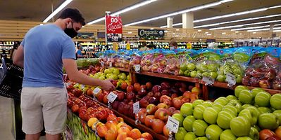 Customers shop for produce at a supermarket on June 10, 2021 in Chicago, Illinois.