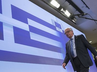 REFILE - CORRECTING TYPO European Commission President Jean-Claude Juncker walks past a giant Greek flag projected in the press room after a statement on the situation on the situation in Greece, at the EU commission headquarters in Brussels, Belgium June 29, 2015. Greeks woke up to shuttered banks, closed cash machines and a climate of rumours and conspiracy theories on Monday as a breakdown in talks between Athens and its creditors plunged the country deep into crisis. REUTERS/Yves Herman