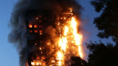 "TOPSHOT - Fire engulfs Grenfell Tower, a residential tower block on June 14, 2017 in west London. The massive fire ripped through the 27-storey apartment block in west London in the early hours of Wednesday, trapping residents inside as 200 firefighters battled the blaze. Police and fire services attempted to evacuate the concrete block and said ""a number of people are being treated for a range of injuries"", including at least two for smoke inhalation.   / AFP PHOTO / Daniel LEAL-OLIVAS"