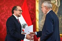 Austria's new Chancellor Alexander Schallenberg (L) shakes hands with Austria's President Alexander Van der Bellen during a swearing-in ceremony at the Presidential Hofburg palace in Vienna, Austria, on October 10, 2021. - Former Foreign Minister Alexander Schallenberg takes over as Austrian chancellor after Sebastian Kurz on October 9, 2021 announced he was stepping down as chancellor following pressure on him to resign after he was implicated in a corruption scandal. (Photo by Joe Klamar / AFP)