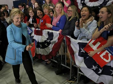 """Democratic U.S. presidential candidate Hillary Clinton walks past supporters as she attends a """"Get Out the Vote"""" campaign rally in Hudson, New Hampshire on Monday."""