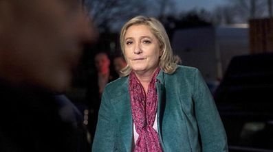 President of the far-right Front National (FN) party, and chief candidate Marine Le Pen arrives for a televised debate on December 9, 2015 in the studios of French channel Grand Lille TV in Lille, ahead of the second round of the French regional elections in the Nord-Pas-de-Calais-Picardie region. / AFP / PHILIPPE HUGUEN