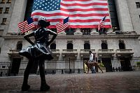 The Fearless Girl statue  is seen in front of the New York Stock Exchange (NYSE) on April 30, 2020 in New York City. - Wall Street stocks opened lower Thursday following another spike of jobless claims in the wake of coronavirus shutdowns, offsetting strong results from tech giants. Another 3.84 million US workers filed for unemployment benefits last week and the total has now passed 30 million in six weeks, according to the Labor Department data. (Photo by Johannes EISELE / AFP)