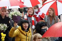 Women chant slogans as they take part in a women march to protest against Belarus' Presidential election results and police violence during a traditional Women's March in Minsk, on October 24, 2020. (Photo by Stringer / AFP)
