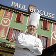 This Thursday, March 24, 2011 photo shows French Chef Paul Bocuse as he poses outside his famed Michelin three-star restaurant L'Auberge du Pont de Collonges in Collonges-au-Mont-d'or, central France. Bocuse, the icon of French cuisine whom many credit with transforming the role of chef from invisible artist to celebrity, will be proclaimed Chef of the Century by the Culinary Institute of America on March 30. (AP Photo/Laurent Cipriani)