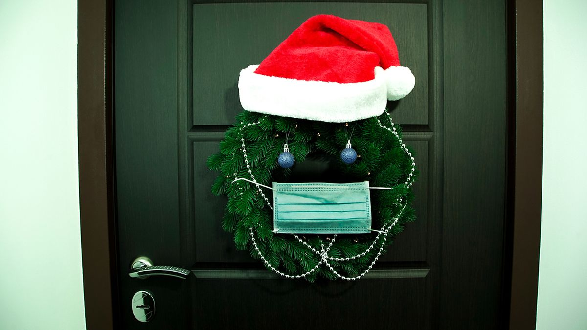 Make a new seasonal door wreath from old (washed) masks, peppered with mini hand sanitizers Photo: Shutterstock