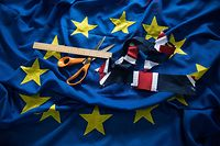 Offcuts from a Union Flag, scissors and a ruler are placed on a newly created European Union (EU) flag in the factory of Flying Colours Flagmakers Ltd in Knaresborough, northern England on February 7, 2019. - At a flag-making workshop in northern England, orders for Unions Flags are flying while the EU's blue-and-yellow standard is proving less and less popular. Flying Colours, which makes flags for Britain's royal palaces, has seen EU flag orders drop by 90 percent since the country voted to leave the bloc in 2016. (Photo by OLI SCARFF / AFP)