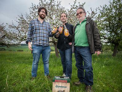 Adie Kaye, CEO Carlo Hein and Gérard Bisenius in the orchard near Mompach