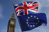 (FILES) In this file photo taken on March 25, 2017 an EU flag and a Union flag held by a demonstrator are seen with Elizabeth Tower (Big Ben) and the Houses of Parliament in London. - Four and a half years after Britain voted to leave the EU and as eight months of painstaking trade talks reach a climax, Boris Johnson is set on December 13, 2020, to answer the most fundamental question: what is Brexit? Britain left the EU in January and is in a standstill transition period until December 31 while both sides thrash out the terms of their new trading relationship. (Photo by Daniel LEAL-OLIVAS / AFP)
