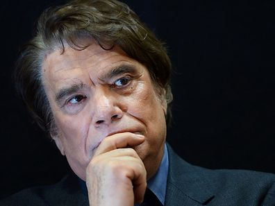 (FILES) - A photo taken on November 15, 2013 shows French businessman Bernard Tapie, owner of the French newspaper La Provence, posing as he attends the inauguration of an auto show in Marseille, southern France. Bernard Tapie will have to pay back 404,623,082.54 euros obtained in 2008, to put an end to a dispute with the French banking group Credit Lyonnais concerning the resale of the Adidas company in 1994, the Paris appeal aourt announced on December 3, 2015. / AFP / BORIS HORVAT
