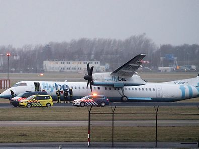 A plane of FlyBe airlines is seen of the runway of Schiphol airport after landing gear broke in high winds