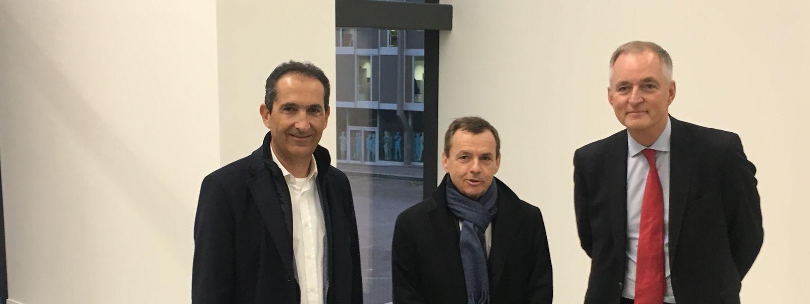 Le président des deux conseils d'administration, d'Altice Europe et Altice USA Patrick Drahi, son p.-d.g. d'Altice France et ami Alain Weill et le président de l'UE 57 Jean Poulaillon (d. g. à d.).