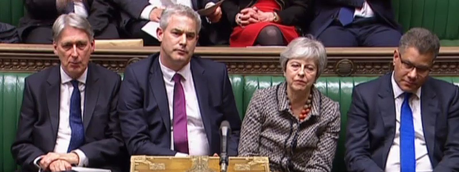 """A video grab from footage broadcast by the UK Parliament's Parliamentary Recording Unit (PRU) shows Britain's Chancellor of the Exchequer Philip Hammond (2L), Britain's Secretary of State for Exiting the European Union (Brexit Minister) Stephen Barclay (C) and Britain's Prime Minister Theresa May listen as opposition leader Jeremy Corbyn speaks in the House of Commons in London on April 1, 2019, following the outcome of the second round of indicative votes on the alternative options for Brexit. - British MPs tried again to chart a new Brexit path on April 1 after rejecting Prime Minister Theresa May's deal for a third time, but the EU warned its patience was wearing thin. (Photo by - / PRU / AFP) / RESTRICTED TO EDITORIAL USE - MANDATORY CREDIT """" AFP PHOTO / PRU """" - NO USE FOR ENTERTAINMENT, SATIRICAL, MARKETING OR ADVERTISING CAMPAIGNS"""