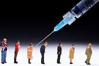 This picture taken on January 5, 2021, in Paris, shows figurines and a syringe to illustrate people receiving Covid-19 (novel coronavirus) vaccinations. - EU nations started their Covid-19 vaccination campaigns with their most vulnerable groups on December 27, 2020, as a new coronavirus variant spread internationally and the WHO warned the current pandemic will not be the last. (Photo by JOEL SAGET / AFP)