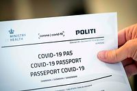 Picture taken on July 10, 2020 shows a Covid-19 passport printed from a website in Copenhagen, on July 10, 2020. - With the new Covid-19 passport issued be the Danish authorities, Danes now have official documentation for testing on their travels abroad. (Photo by Ida Marie Odgaard / Ritzau Scanpix / AFP) / Denmark OUT