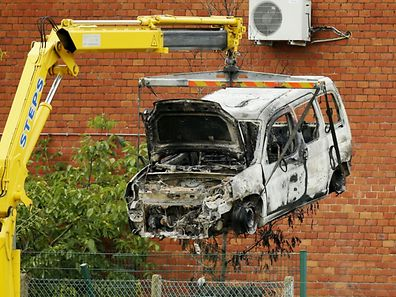 "This picture taken on August 29, 2016, shows the burnt car used to ram raid the National Institute for Criminalistics and Criminology (INCC-NICC) overnight in Neder-Over-Heembeek.  An explosion ""of criminal origin"" at Belgium's national criminology institute in Brussels early on August 29, 2016, caused a fire and major damage but no casualties, officials said. Belgian media said the blast was caused by a car which rammed the building. It comes as Belgium remains on high alert following the devastating Islamic State-claimed suicide attacks on the city's airport and metro in March.  / AFP PHOTO / BELGA / THIERRY ROGE / Belgium OUT"