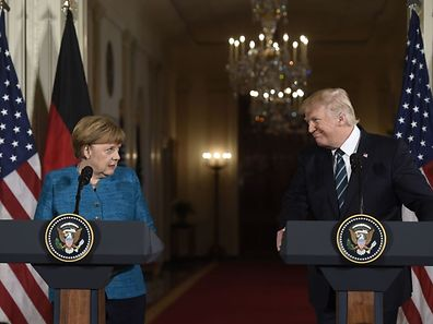 US President Donald Trump and German Chancellor Angela Merkel hold a joint press conference in the East Room of the White House in Washington, DC, on March 17, 2017.