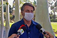 "TOPSHOT - Screen grab of TV Brasil showing Brazilian President Jair Bolsonaro speaking at Planalto Palace in Brasilia on July 7, 2020. - Brazil President Jair Bolsonaro announced on Tuesday he had tested positive for the coronavirus but said he was feeling ""perfectly well"" and had only mild symptoms. (Photo by - / TV BRASIL / AFP)"