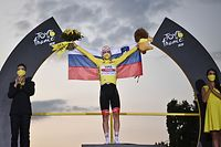 Team UAE Emirates rider Slovenia's Tadej Pogacar wearing the overall leader's yellow jersey celebrates on the podium after winning the 107th edition of the Tour de France cycling race, after the 21st and last stage of 122 km between Mantes-la-Jolie and Champs Elysees Paris, on September 20, 2020. (Photo by Anne-Christine POUJOULAT / AFP)