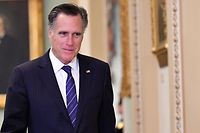 US Senator Mitt Romney (R-UT) is seen during a recess of the impeachment trial proceedings of US President Donald Trump on Capitol Hill January 30, 2020, in Washington, DC. - The fight over calling witnesses to testify in President Donald Trump's impeachment trial intensified January 28, 2020 after Trump's lawyers closed their defense calling the abuse of power charges against him politically motivated. Democrats sought to have the Senate subpoena former White House national security advisor John Bolton to provide evidence after leaks from his forthcoming book suggested he could supply damning evidence against Trump. . (Photo by Mandel NGAN / AFP)