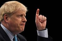 "Britain's Prime Minister Boris Johnson delivers his keynote speech to delegates on the final day of the annual Conservative Party conference at the Manchester Central convention complex, in Manchester, north-west England on October 2, 2019. - Prime Minister Boris Johnson was set to unveil his plan for a new Brexit deal at his Conservative party conference Wednesday, warning the EU it is that or Britain leaves with no agreement this month. Downing Street said Johnson would give details of a ""fair and reasonable compromise"" in his closing address to the gathering in Manchester, and would table the plans in Brussels the same day. (Photo by Ben STANSALL / AFP)"