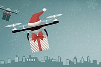 Drones with Santa's hat delivering Christmas gifts in the city and snow falling