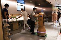 BEIJING, CHINA - MAY 01: A robot delivers food at a Haidilao Hotpot restaurant on May 1, 2020 in Beijing, China. (Photo by Jiang Qiming/China News Service via Getty Images)