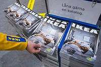 Catalogues are placed for people to take at the entrance to one of the stores of the Swedish furniture giant Ikea on December 7, 2020 in Jarfalla, near Stockholm. - Swedish furniture giant Ikea said Monday, December 7, 2020 it would stop printing its famed physical catalogue, printed yearly in tens of millions of copies, after 70 years, as customers move to digital alternatives. (Photo by Jonathan NACKSTRAND / AFP)