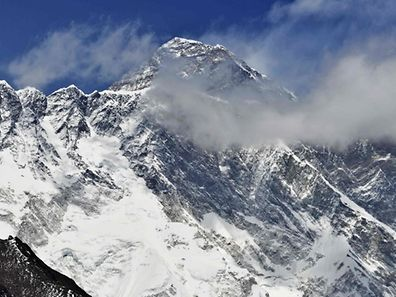 "(FILEs) In this photograph taken on April 20, 2015, Mount Everest (Background) and the Nupse-Lohtse massif (Foreground)  are seen from the village of Tembuche in the Kumbh region of north-eastern Nepal. An American climber died May 21, 2017 on his way to the summit of Mount Everest, expedition organisers said, the latest death to mar the ongoing climbing season. The 50-year-old mountaineer died close to the Balcony, a small platform above the 8,000-metre mark considered the mountain's ""death zone"". / AFP PHOTO / ROBERTO SCHMIDT"