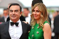 (FILES) This file photo taken on May 26, 2017 shows then-Renault CEO Carlos Ghosn (L) and his wife Carole arriving for the screening of the film 'L'Amant Double' (Amant Double) at the 70th edition of the Cannes Film Festival in Cannes. - Prosecutors in Japan have obtained an arrest warrant for Carole Ghosn, wife of former Nissan chief Carlos Ghosn, who last month jumped bail and fled Japan, local media reported on January 7, 2020. (Photo by LOIC VENANCE / AFP)