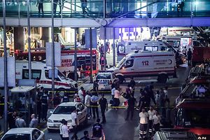 Forensic police work the explosion site at Ataturk airport on June 28, 2016 in Istanbul after two explosions followed by gunfire hit Turkey's biggest airport, killing at least 28 people and injured 20.  All flights at Istanbul's Ataturk international airport were suspended on June 28, 2016 after a suicide attack left at least 10 people dead and 20 others wounded, Turkish television stations reported.  / AFP PHOTO / OZAN KOSE