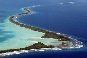 (FILES) This file photo taken on February 22, 2004 shows the coastline of Funafuti, an atoll of Tuvalu.  President of the Assembly of French Polynesia Marcel Tuihani expressed his 'stupefaction' after US President Donald Trump's decision to withdraw from the Paris climate accord. In Tuvalu, part of the cultivatable lands, were submerged by seawater and most of the soils are no longer fertile.  / AFP PHOTO / TORSTEN BLACKWOOD