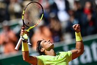 Spain's Rafael Nadal celebrates after winning against Switzerland's Roger Federer during their men's singles semi-final match on day 13 of The Roland Garros 2019 French Open tennis tournament in Paris on June 7, 2019. (Photo by Martin BUREAU / AFP)