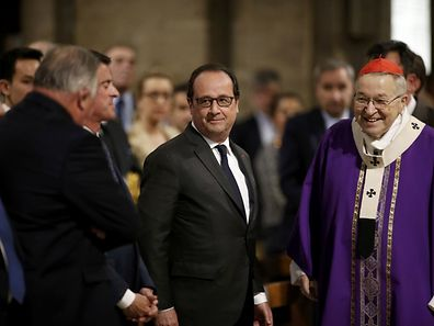 French President François Hollande (c.) speaks with French Archbishop of Paris Cardinal Andre Vingt-trois (r.) before a mass to pay tribute to French priest Father Jacques Hamel at the Notre-Dame Cathedral in Paris.