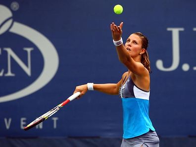 NEW YORK, NY - AUGUST 27: Mandy Minella of Luxembourg serves against Olivia Rogowska of Australia during their women's singles first round match Day One of the 2012 US Open at USTA Billie Jean King National Tennis Center on August 27, 2012 in the Flushing neigborhood of the Queens borough of New York City.   Alex Trautwig/Getty Images/AFP== FOR NEWSPAPERS, INTERNET, TELCOS & TELEVISION USE ONLY ==