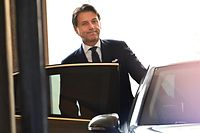 Italy�s Prime Minister Giuseppe Conte guets into his car as he leaves after attending a meeting at the Senate, after he was given by the Italian president a mandate to form a new government, on August 29, 2019 in Rome. - The anti-establishment Five Star Movement (M5S) and the centre-left Democratic Party (PD), once bitter foes, agreed on August 28 to govern in coalition following the collapse of Italy's populist government earlier this month. (Photo by Andreas SOLARO / AFP)