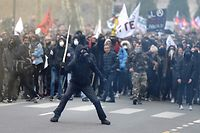 TOPSHOT - Demonstrators clash with riort police on March 22, 2018 in Nantes as part of a nationwide day of protest against French president multi-front reform drive. Seven trade unions have called on public sector workers to strike on March 22, including school and hospital staff, civil servants and air traffic controllers. More than 140 protests are planned across France, the biggest culminating at the Bastille monument in Paris where unions expect 25,000 demonstrators.  / AFP PHOTO / JEAN-SEBASTIEN EVRARD
