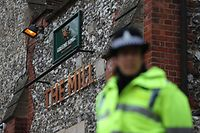 A police officer stands in front of The Mill pub in Salisbury, southern England, on March 11, 2018, as investigations continue in connection with the major incident sparked after a man and a woman were apparently poisoned in a nerve agent attack a week ago. Traces of a nerve agent used in the suspected attempted murder of a Russian ex-spy have been found in a pub and a restaurant he visited, England's chief medical officer said on March 11. Sally Davies said up to 500 people who had visited The Mill pub and the Zizzi restaurant in Salisbury, southwest England, needed to wash their clothes and belongings as a precaution. The March 4 attack on Russian double agent Sergei Skripal and his daughter Yulia is being treated by detectives as attempted murder.  / AFP PHOTO / Daniel LEAL-OLIVAS