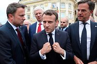 L to R, Luxembourg's Prime Minister Xavier Bettel, Latvia's Prime Minister Krisjanis Karins, France's President Emmanuel Macron and Netherlands' Prime Minister Mark Rutte meets with young environmentalists handing them a letter at a EU summit in Sibiu, central Romania on May 9, 2019. - European Union leaders will meet on Thursday to set out a course for increased political cooperation in the wake of the impending departure of the United Kingdom from the bloc. (Photo by Ludovic MARIN / AFP)