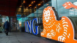 FILE PHOTO: A man walks past the logo of ING Group NV at a branch office in Amsterdam, Netherlands January 9, 2014.  REUTERS/Toussaint Kluiters/File photo