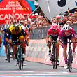 Italy's rider of team Quick-Step Elia Viviani (R) crosses the finish line to win the 13th stage between Ferrara and Nervesa della Battaglia of the 101st Giro d'Italia, Tour of Italy cycling race, on May 18, 2018.  / AFP PHOTO / LUK BENIES